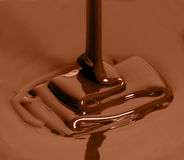 Cup of melted chocolate Stock Photo