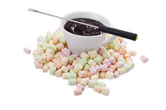 Cup of melted chocolate in pile of colorful marshmallow Stock Image