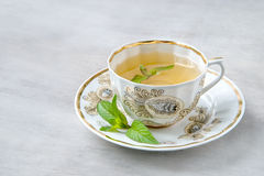 Cup of menth tea. Close-up, selective focus Royalty Free Stock Image