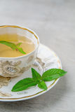 Cup of menth tea. Close-up, selective focus Royalty Free Stock Photography