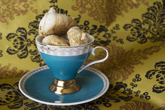Cup of meringues. Cup filled with meringues with patterned background Stock Images