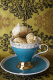 Cup of meringues. Cup filled with meringues with patterned background Royalty Free Stock Photography