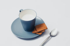 Cup of mil with biscuits. White background. Stock Photo