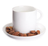 A cup of milk with almonds isolated Royalty Free Stock Photography