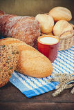Cup of milk with assortment of baked bread Stock Images