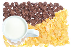 Cup of milk on a background corn flakes. Royalty Free Stock Photos