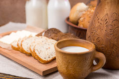 Cup of milk with bread for a healthy breakfast Stock Photo