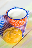 Cup of milk and bread on napkin Stock Photo
