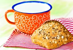 Cup of milk and bread on napkin Stock Photos