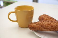Cup of milk and bread with sesame royalty free stock photography