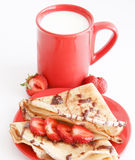 Cup of milk and cakes with strawberry. Sweet meal with cup of milk and cakes and chocolate and strawberries royalty free stock photos