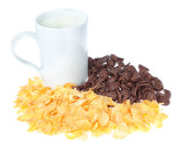 Cup of milk and chocolate corn flakes. Royalty Free Stock Photography