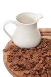 Cup with milk and chocolate cornflakes Royalty Free Stock Images
