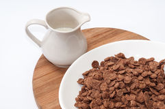 Cup with milk and chocolate cornflakes Stock Photos