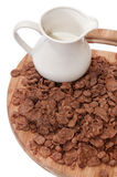Cup with milk and chocolate cornflakes Stock Photo