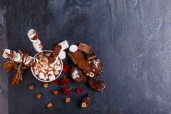 A cup of milk chocolate with marshmallows and marshmallows on a stick in chocolate. View from above royalty free stock photography
