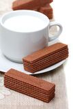 Cup of milk and chocolate wafers. Royalty Free Stock Photography