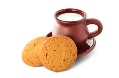 Cup of milk and cookies. Earthenware mug of milk and two cookies Royalty Free Stock Photo