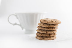 Cup of milk and cookies. Isolated on white Stock Image