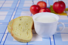 Cup of milk with a cornbread and apples Royalty Free Stock Photography