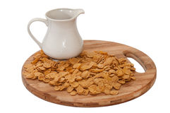 Cup with milk and cornflakes on the board Royalty Free Stock Photography