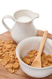 Cup of milk and cornflakes in the bowl Stock Photo