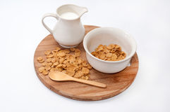 Cup of milk and cornflakes in the bowl Stock Photography