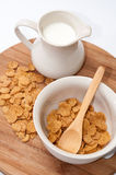 Cup of milk and cornflakes in the bowl Royalty Free Stock Image