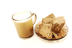 A cup of milk and halva Royalty Free Stock Photography