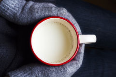 Cup of milk in hand with gloves Stock Photography