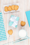 Cup of milk, heart shaped cookies, gift box and notepad Stock Photo
