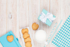 Cup of milk, heart shaped cookies, gift box and notepad Royalty Free Stock Image