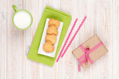 Cup of milk, heart shaped cookies and gift box Royalty Free Stock Photo
