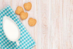 Cup of milk and heart shaped cookies Stock Photography