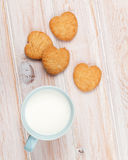 Cup of milk and heart shaped cookies Stock Photo