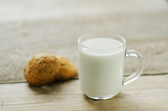 Cup of milk with oatmeal cookies Stock Images
