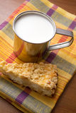 Cup of milk and a piece of cake Royalty Free Stock Photo