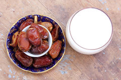 Cup of milk with ripe dates Royalty Free Stock Image