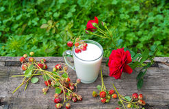 Cup of milk and  strawberries Royalty Free Stock Images