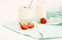 Cup of milk with strawberries Royalty Free Stock Photo