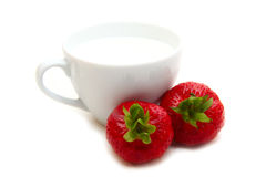 Cup of milk and strawberries. On a white background Royalty Free Stock Photo