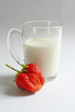 Cup of milk with strawberry. On white background royalty free stock photography