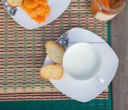 A cup of milk with tangerine marmalde Stock Photography