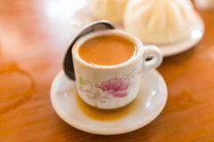 Cup of milk tea and steamed bun Stock Photo