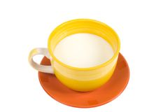 Cup of milk on white background. Yellow cup of milk isolated on white background Royalty Free Stock Image