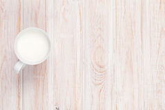 Cup of milk on white wooden table Royalty Free Stock Photography