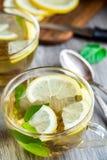 Cup with mint and lemon tea Stock Photos