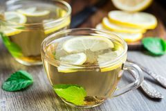 Cup with mint and lemon tea Royalty Free Stock Photos