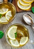Cup with mint and lemon tea Royalty Free Stock Image