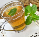 Cup of mint tea with a sprig of mint Stock Photos
